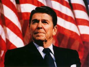 Image of President Ronald Reagan in 1982. He is standing in front of the American flag.